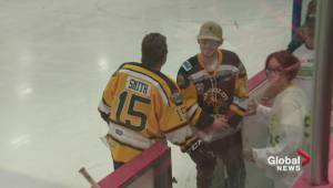 Humboldt Bronco Tyler Smith attends hockey game in Leduc put on in his honour
