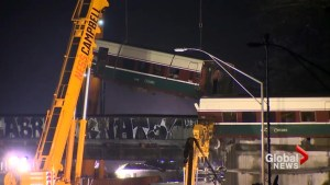 Derailed Amtrak train lifted off Seattle area highway