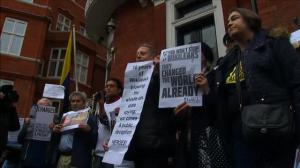 Protesters gather outside Ecuadorian embassy in support of Julian Assange