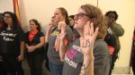People protest outside Jeff Flake's office during procedural vote