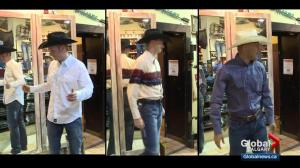 Global Calgary stampede newbies try out their cowboy duds