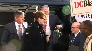 Supporters serenade Michael Flynn as he enters court house to be sentenced for lying to FBI
