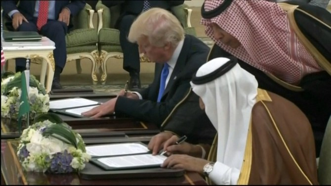 Risultati immagini per Donald Trump signs $110 billion arms deal with Saudi Arabia