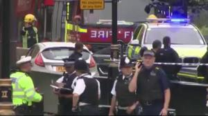 Car runs into people outside British parliament building in London