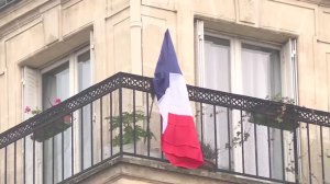 Parisians display French flag on balconies to pay respects to victims of Paris attacks