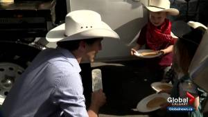 Prime Minister visits Calgary Stampede with a message about pipelines and compromise