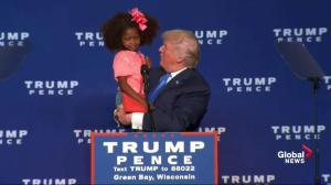 Trump brings on stage mini supporters during rally in Wisconsin