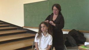 Montreal student cutting hair for MS