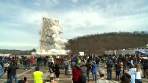 Crowd gathers up close to watch building implosion in Kentucky