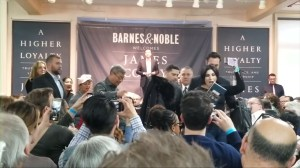 Woman escorted out of James Comey book signing as event met by small protest