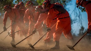 California is using inmates to fight wildfires, and they're paid $2 a day