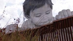 Artwork shows child looking over US-Mexico border