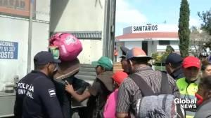Migrants board trucks as caravan continues its journey toward U.S. border (01:16)