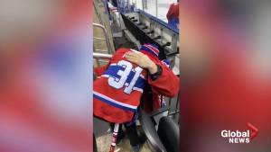 Montreal Canadiens' Carey Price hugs young boy who lost his mother