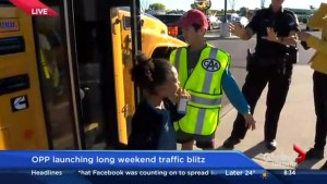 Looking out for school buses on the road as kids head back to class