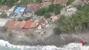 Indonesian officials take aerial tour of tsunami swamped areas