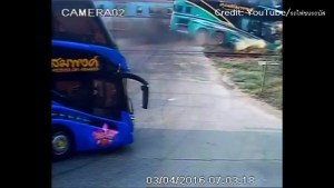 Bus collides with train at crossing in Thailand