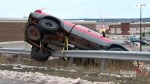 Truck seen over guardrail after briefly dragging man in Toronto area