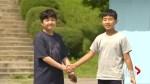 Tourists recreate historic handshake between Korean leaders