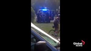 Man in custody after Edmonton police officer on bike struck by vehicle