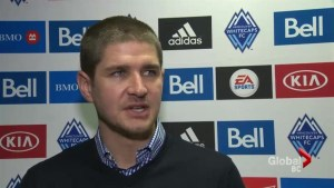 Whitecaps re-sign head coach Carl Robinson