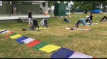 Stretching out at Del Crary Park at the annual Peterborough Yoga Festival