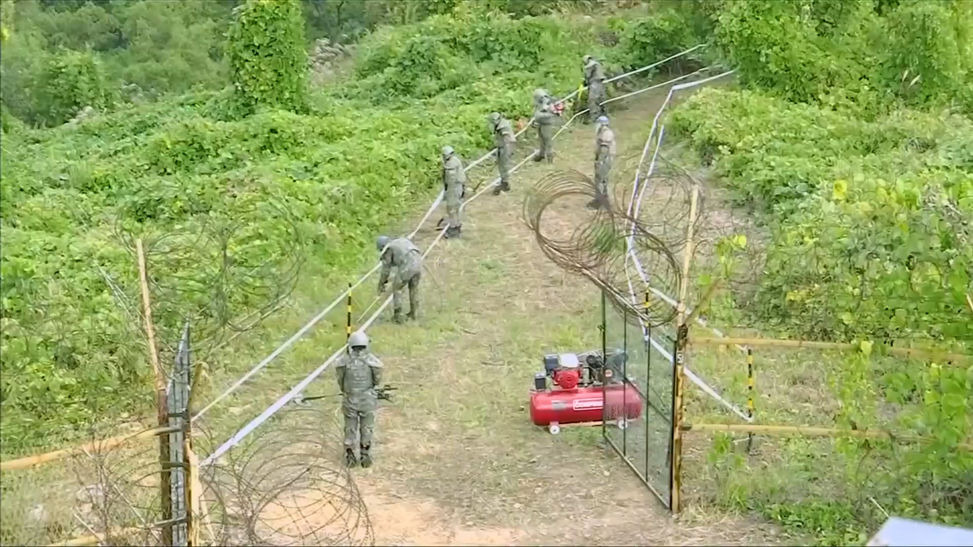 Koreas removing some armed guard posts from demilitarized zone