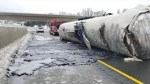 Trailer rolls onto westbound lanes near Brighton, spilling hot tar across highway