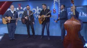 """RCAF Band and Doc Walker perform """"Santa Clause is Coming to Town"""""""