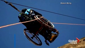 Wheelchair-bound man scales mountain