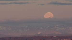 The moon sets over the Rockies