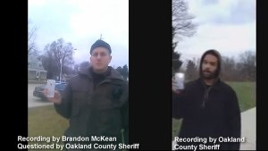 Man and Michigan policeman record their tense interaction on cell phones
