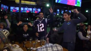 New England Patriots fans celebrate team's win as they head to the Super Bowl