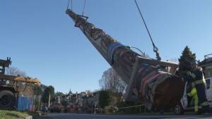Vancouver's iconic Centennial Totem Pole is removed for repair