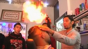 'Blowtorch barber' offers flame-straightened hair styling in Gaza