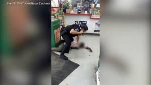 Police investigating after video shows officer beating homeless woman with baton