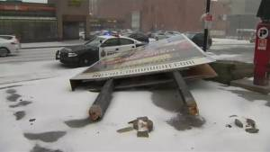 Man in critical condition after sign collapses on top of him as winter storm hits Hamilton