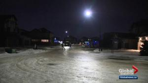 Road in Edmonton so icy people are skating on it
