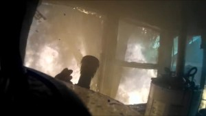Dramatic helmet cam footage shows what firefighters face inside a burning home