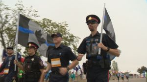 Sask. police honour fallen Fredericton officers at Queen City Marathon