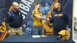 London football star signs with Queen's