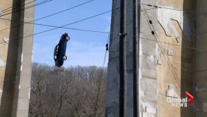 Car hangs from bridge on wire, Toronto police unsure how it got there