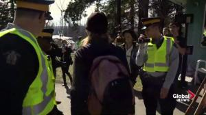 Police ask Kinder Morgan protesters to leave site before placing some under arrest