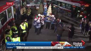 Calgary police, fire crews help out at 2nd annual Morning of Giving