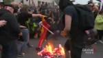 Flag burned, flares lit at G7 protest in Quebec