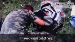 Shocking new video shows Ukrainian rebels sifting through fresh wreckage of MH17