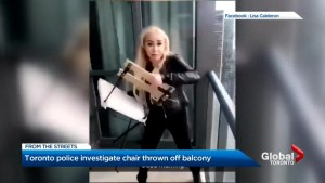 Police investigate video showing woman tossing chair off Toronto high rise