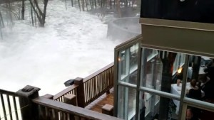 Gatineau River rushes past Wakefield Mill restaurant north of Ottawa