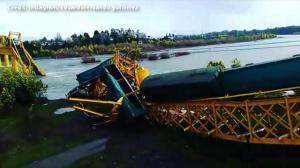 Bridge collapse causes train to plunge into river in Chile