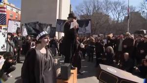 Anti-Trump protesters hold mock funeral for the US presidency